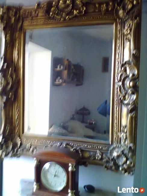 lustra w ramach złoconych