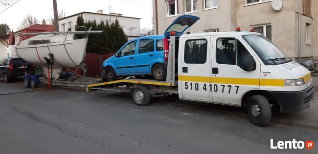 Pomoc drogowa Ostróda 24 holowanie transport laweta 7 osób