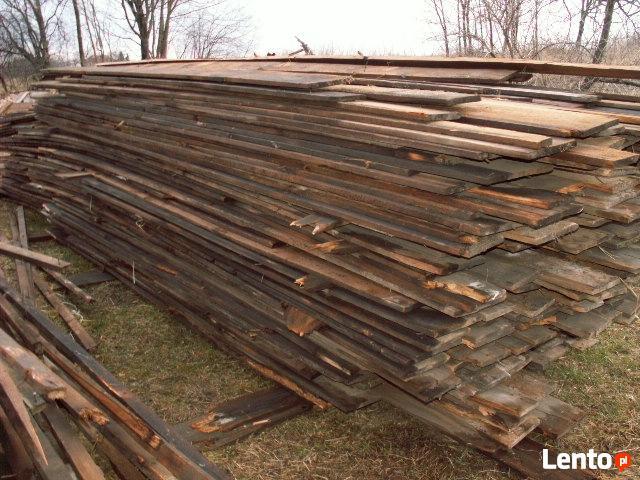 stare drewno rozbiórkowe bale deski cegła czerwona szamotowa
