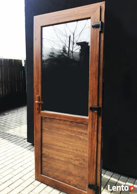 DRZWI PCV w kolorze złoty dąb szyba panel 100x200