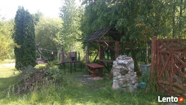 domek drewniany nad jeziorem Mazury