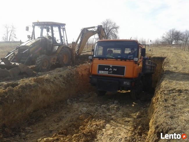 Wywóz Ziemi Gruzu Wyburzenia Rozbiórki koparko ładowarka