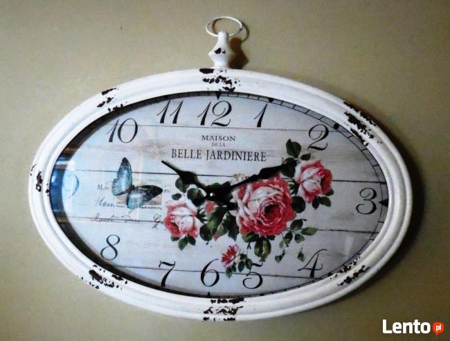 owalny zegar ścienny w stylu retro z motywem kwiatowym