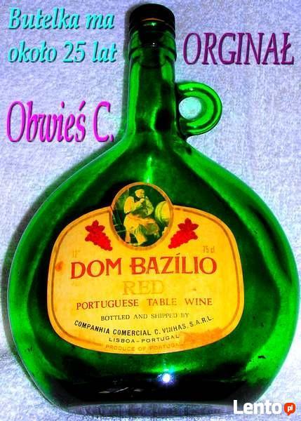 """Butelka po """"DOM BAZILIO""""."""