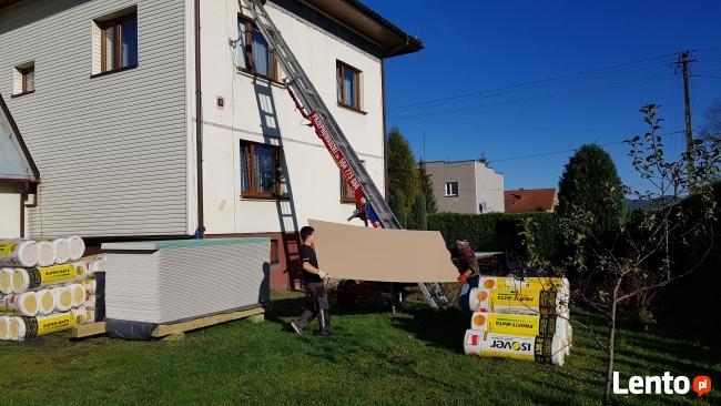 Dostarczenie materiałów budowlanych oknem balkonem gruzu