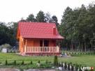 Domek drewnia na jeziorem Miłki