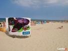 Przebieralnie plażowe - nośniki reklamy - producent, montaż Czosnów