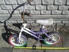 Mały rowerek dziecinny z kolorowymi kolami, 30zł.