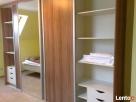 Meble na wymiar, szafy wnękowe, garderoby Lesko
