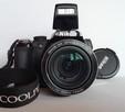 Nikon Coolpix P90 z torbą podróżną i zapasową baterią