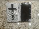 Książka z granitu.rzeźbiona.portrety.nagrobki