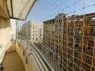 Montaż siatki na balkon przeciw gołębiom dla kota - 4